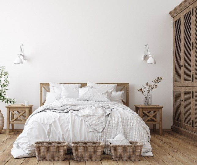 A nice bed in a Scandinavian bedroom